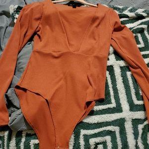 Soft orange body suit